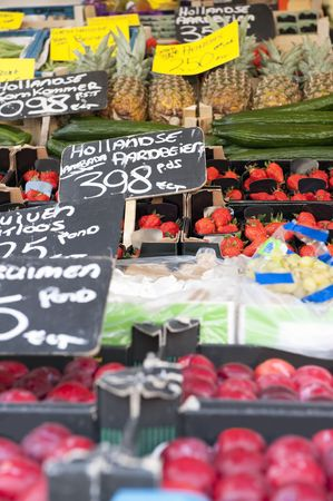 Fresh fruits at a greengrocers stall focus on the strawberries photo