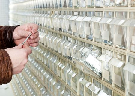 hardware store: Buying split pens a hardware store with endless rows of shelves Stock Photo