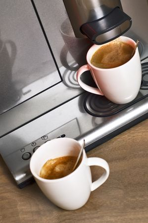with coffee maker: Modern, steel, pad coffee maker with two porcelain cups Stock Photo