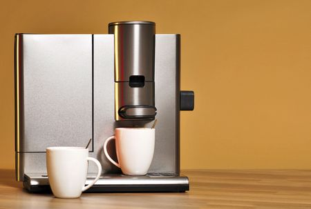 coffeemaker: Stylish coffeemaker with two coffee cups on a wooden surface Stock Photo