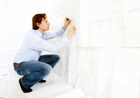 An industrial design engineer checking technical drawings photo