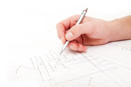 Hand, holding a refillable pencil, checing the measurements and tolerances on a technical drawing photo