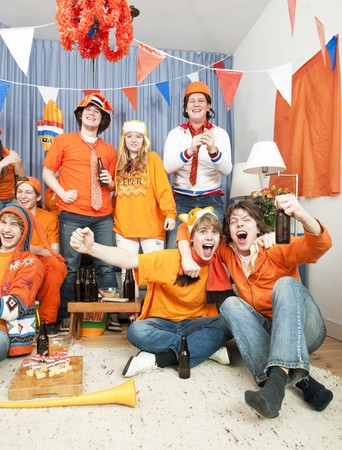 Happy soccer fans see their national team win at home photo