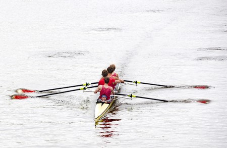 collegiate: Coxed four rowing towards the camera, on a bleak day in open water Stock Photo