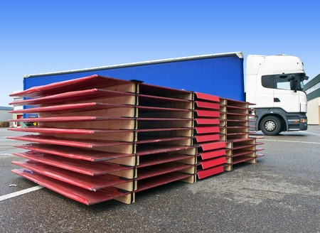 International transport concept, with a pallet ready to be loaded onto a waiting truck photo