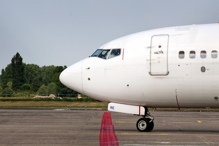Close up of a taxiing commercial airliner, ready for departure photo