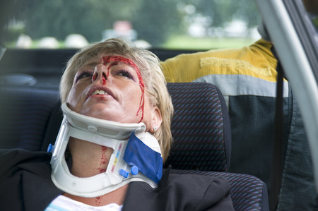 injure: woman with a neck brace to support her spinal cord after a severe car accident