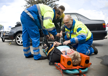 paramedic: firefighter and paramadic stabilize a victim. Stock Photo
