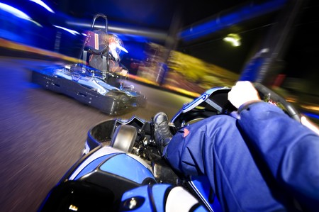 Go-carts in pursuit on an indoor race track