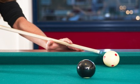 cue stick: Close up of cue ball and cue stick during a game of pool