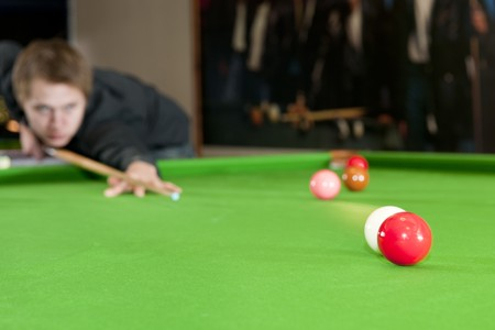 snooker rooms: Cue ball colliding with a red ball on a snooker table Stock Photo