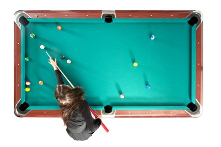 Pool table with a girl playing, seen from above, isolated on white photo