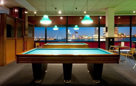 pool room: Retro pool room with a magnificent view on a city skyline