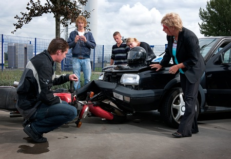 People examining the exterior damage to their vehicles after a car crash Stock Photo - 8523363