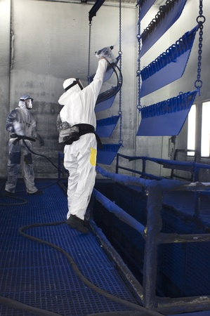 Semi finished parts are being spray painted in a factory Stock Photo - 8728107