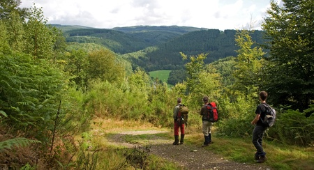 A group of hikers enjoying the view in the Ardennes mountain range. photo