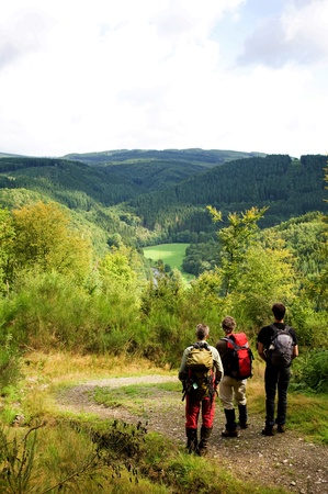 A group of hikers enjoying the view over the Ardennes mountains in the late summer. photo