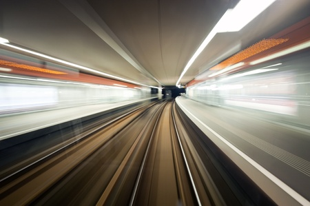 road tunnel: Subway train, driving at speed past a station