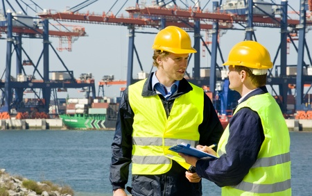 Two dockers at work in a big container harbor photo