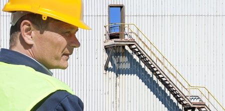 Portrait of an Industrial supervisor in front of an old factory photo