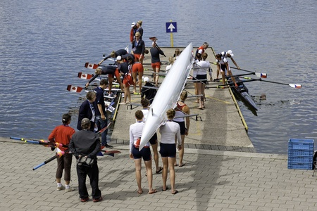 carying: Bosbaan, Amsterdam, the Netherlands - 22 July 2011: Busy times at the Bosbaans Boat area, where the womens 8s of Canada and the US are preparing for their race