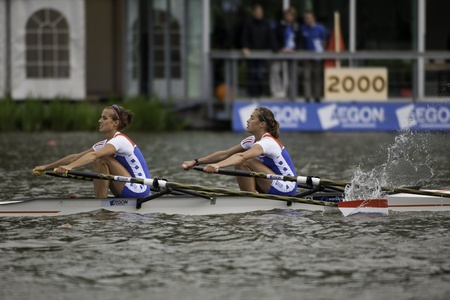 Bosbaan, Amsterdam, Netherlands - 23 July 2011: Final strokes before crossing the finish line of the Dutch Lightweight Women's double sculls (Worner, Leijssen) Stock Photo - 10006943
