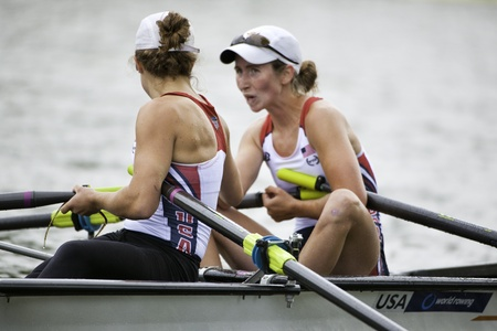 Bosbaan, Amsterdam, Netherlands - 23 July 2011: USA's Keller and Bates congratulate eachother after reaching the finals of the world championships under 23 Stock Photo - 10006937