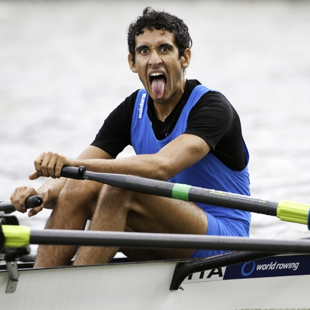 Bosbaan, Amsterdam, Netherlands - 23 July 2011: Italy's Lightweight Double Sculls Bowman, Leonardo Boccuni, sticks out his tongue after finishing the semi finals in second place, thus reaching the finals of the world championships under 23 Stock Photo - 10006907