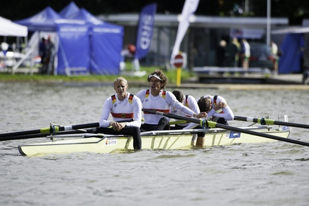 finals: Bosbaan, Amsterdam, Netherlands - 23 July 2011: The Exhausted German Lightweight Mens Four reaching the finals of the world championships under 23 in a world best time of 5:58.07