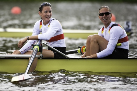 world record: Bosbaan, Amsterdam, Netherlands - 23 July 2011: Germanys Womens Four has just become world champion under 23 in a world record time of 6:34.61 Editorial