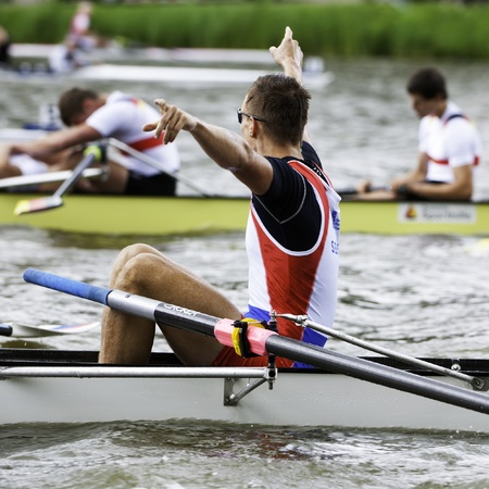 world record: Bosbaan, Amsterdam, Netherlands - 23 July 2011:  Serbias Mens Coxed four wins gold at the world championships rowing under 23 in a world record time of 6:03.01. The defeated german team in the background