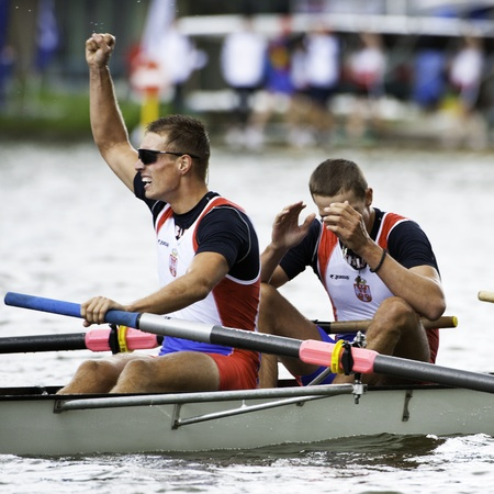 world record: Bosbaan, Amsterdam, Netherlands - 23 July 2011:  Serbias Mens Coxed four wins gold at the world championships rowing under 23 in a world record time of 6:03.01 Editorial