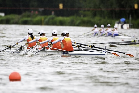 quadruple: Bosbaan, Amsterdam, Netherlands - 23 July 2011: Chinas Lightweight womens quadruple sculls is about to become world champion with a world record time of 6:30.71 Editorial