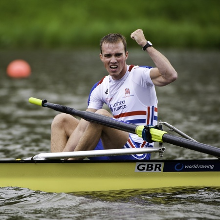 world record: Bosbaan, Amsterdam, Netherlands - 23 July 2011:  Great Britains Peter Chambers cheers after winning the gold medal in a world record time of 6:26.90 at the world championships rowing under 23 Editorial