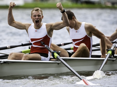 Bosbaan, Amsterdam, Netherlands - 23 July 2011:  The Danish Lightweight Men's Quadruple Sculls win the gold medal at the world championships under 23. Cheering after finishing the race - viking style. Stock Photo - 10006941