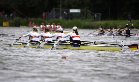 Bosbaan, Amsterdam, Netherlands - 23 July 2011:  Germany's Women's Quadruple Sculls about to win gold medal and set a new world record (6:22.84) at the world championships under 23, in front of New Zealand and Switzerland Stock Photo - 10006909