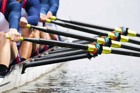 rowing: Close up of a mens quadruple skulls rowing team, seconds after the start of their race