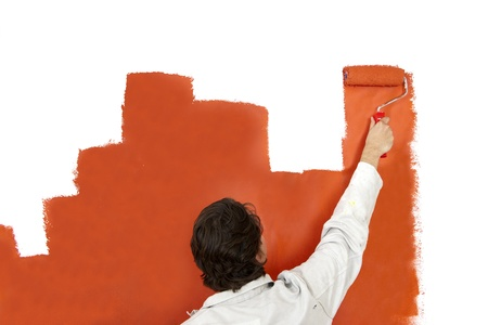 man painting: Painter, painting a wall with a paint roller in the shape of a bar graph
