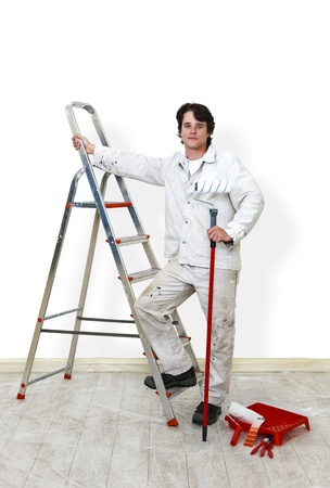 Painter, ready for work, surroudend by supplies Stock Photo - 10476163