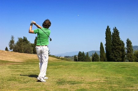 polo player: Golf Player hits his ball on the fairway