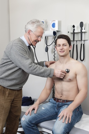 Portrait of young patient getting his medical checkup done by a doctor photo
