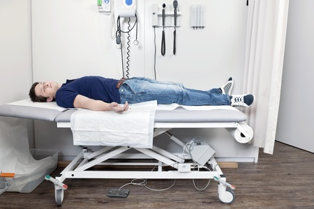 Injured young man resting on the clinic bed Stock Photo - 12852041