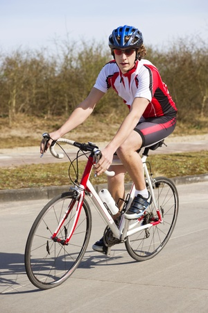 racing bike: Cyclist on a racing bike, looking at the camera Stock Photo