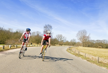 Two cyclists discussing the tactics of their escape, now leading the race photo