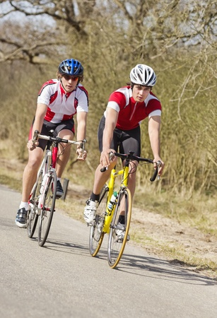 Two cyclists racing closely together at high speed Stock Photo - 13004134