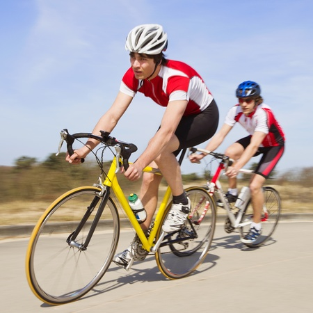 bike race: Two cyclists sprinting past the camera at high speed Stock Photo