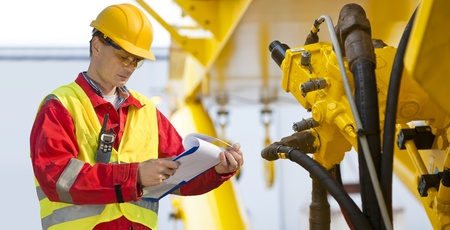 engineering clipboard: Hydraulic engineer doing a safety check on a new installation Stock Photo