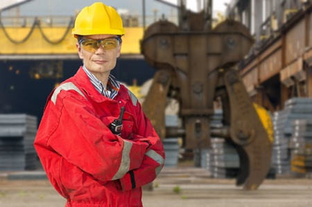 Engineer, posing in front of a steel mill photo
