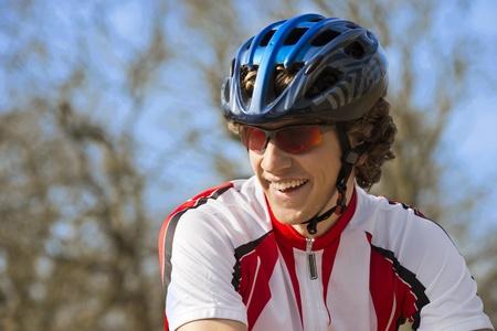 sportsperson: Happy bicyclist in sportswear looking away