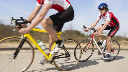 Two active male cyclists riding bike on a country road Stock Photo - 13929344
